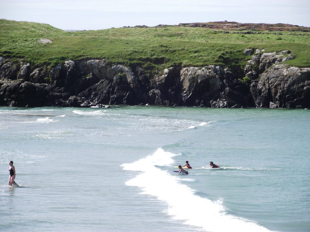 Swimming at Doonloughan Beach - Visit Galway
